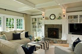 interior fascinating living room with stone fireplaced between shelf and appealing interior wall colors