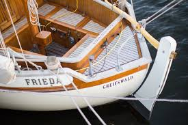 white boat in water foremost boat insurance