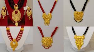 latest light weight gold manglasutra designs with weight latest black bead chain collection with gold pendant