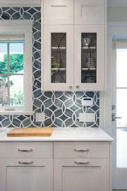 White and blue kitchen boasts white shaker cabinets painted Benjamin Moore  White Heron paired with Princess