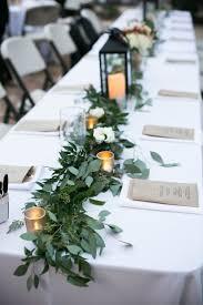 Ashly & Evan  Weddings in Tampa Bay   Greenery garland down the head table  made