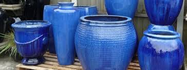 large blue glazed pots and planters