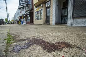 Blood on Elmwood sidewalk attests to violent 18-hour span in Philly