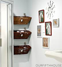 wonderful three rattan towel storage basket hanging on white wall painted added portray frames as decorate in white modern bathroom ideas