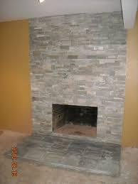 the finished stone veneer fireplace