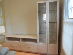 l shaped wall unit in ash matte with glass doors