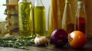 Food ingredients on kitchen table Closeup of onion garlic and