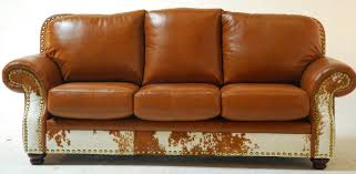 charmingly gold rush upholstery leather couch with pleated roll panel arms and solid brass nails emblazon best quality orange burnt orange furniture