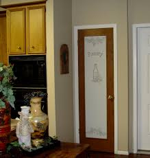casual kitchen design with frosted glass pantry door decorative g printed on glass and