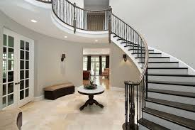 foyer entry with circular staircase seat benches and table