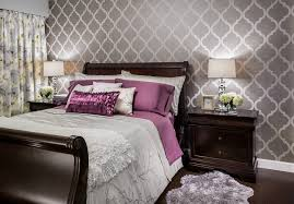 bright quatrefoil bedding in bedroom transitional with sleigh bed next to boutique hotel bedroom alongside bedroom wallpaper and purple grey