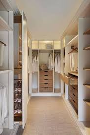 walk closet. Contemporary Closet With Built-in Bookshelf, Carpet, Crown Molding, California Closets Walk