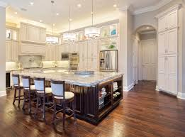 eye catching average kitchen size. Large New Custom Kitchen With Incredible Pendant Lights Above Island, White Backed Stools, Huge Dark Island Wood Flooring. | Eye Catching Average Size T