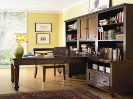 office table decoration. Contemporary Home Office With Den Decorating Ideas Added Brown Wooden Cabinets Feat Rectangle Table On Rugs As Well Yellow Wall Painted Decoration E