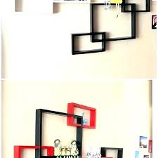 white wall boxes decorative shelves intersecting black red square shadow single wal