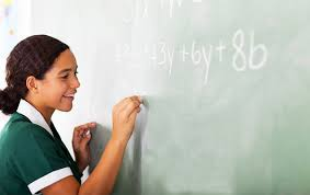 helping math teacher helping child at chalkboard stock photo  common core math situations to avoid when helping your th grader common core math situations to