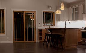 kitchen with mission oak cabinets in island and base oak mullion glass door to patio