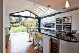 Made To Measure Kitchen Doors Open Plan Kitchen Looking Into A Garden Through Open Folding Doors