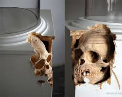 carved axe handle. canadian artist maskull lasserre carves human skeletal features into ordinary wooden implements. he can make an axe handle look like a spine or give carved