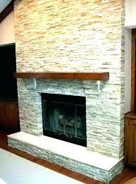 stacked stone tile fireplace around