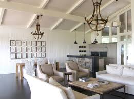 coastal living room with chandeliers