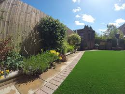 should artificial grass be fixed to