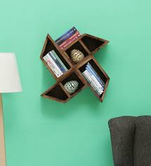 solid wood wall shelf in brown finish by bohemiana