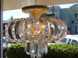 this is a vintage all lucite hanging ceiling mount chandelier with an unusual design this light has a combination of fixed curved lucite ribs that form