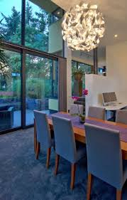 dining room beautiful design ideas using rectangular grey fabric stacking chairs and round white glass