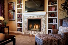 wide screen tv above glass mosaic frame gas fireplace combined with tall narrow white lacquer oak