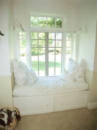 Monochromatic White Room With Bay Window Couch Plus French Windows Also  Pull Out Storages