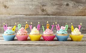 Birthday Cupcakes With Candles On Grey Wooden Background Stock Photo