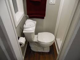 tiny house toilet. Astounding Tiny House Toilets Red Towel White Closet Toilet Paper Frame Window Grey Painted Wall Wooden Floor Faucet U