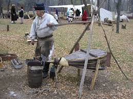 an interpreter is seen here with a portable blacksmith s forge similar to the one taken by