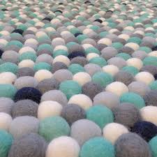 felt ball rug turquoise light blue grey white navy less round