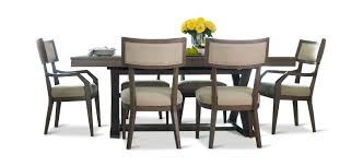 highline trestle table with 4 klismo dining chairs and 2 klismo arm chairs