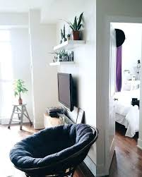 shelf above tv decorate wall behind small laundry area closet organization and room shelving cool ideas