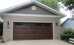 walnut garage doorsTypes of Garage Doors You Can Choose  DesignForLifes Portfolio