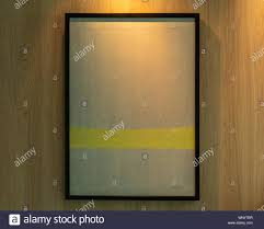 Lighting Frames Blank Modern Black Frames On Wooden Wall With Lighting In