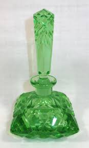 green cut glass perfume bottle