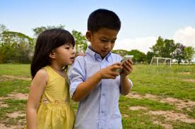 Use Tablet As Phone Little Asian Boy And Girl Use The Smart Phone Tablet For