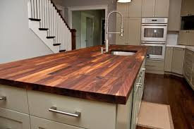 transitional kitchen decoration with walnut butcher block countertops solid brass spring pull out faucets