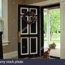 open front door welcome. Noteworthy Open Front Door Cat Sitting At Stock Photo, Royalty Free Image Welcome