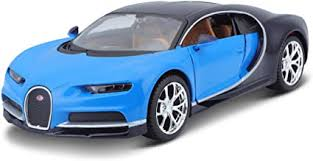 Painted blue to match bugatti's signature color that was inspired by the 1937 bugatti type 57 g that won le mans, the car also wears various black accent pieces. Amazon Com Maisto 1 24 Scale Bugatti Chiron Die Cast Vehicle Colors May Vary Toys Games