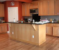 decoration amazing wooden laminating floor with wooden kitchen island with dark glass tabletop also wooden