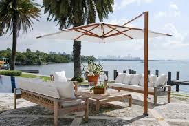 awesome white outdoor furniture with white cushion and white canopy by cantilever umbrella