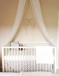 nursery with gold angel wings