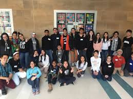 asian american lead middle and high school youth pose for a photo together after completing the guided tour