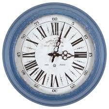 circular iron wall clock in distressed blue frame