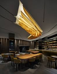 modern bar lighting. modern restaurant interior design love the thick wooden table and hanging ceiling lights bar lighting